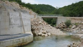 Rubble and bridge and Medna dam