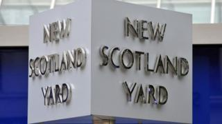 The New Scotland Yard sign outside the Met Police headquarters