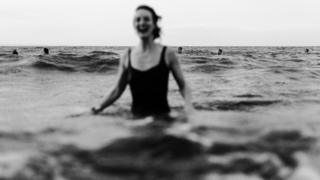 A smiling woman in the sea