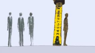 A person standing next to a tape measure