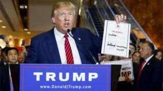 US presidential hopeful Donald Trump holds up a signed pledge during a press availability at Trump Tower in Manhattan, New York on 3 September 2015.