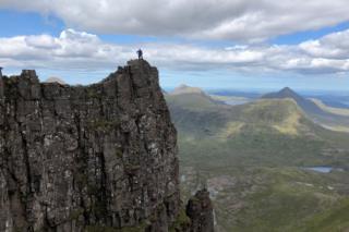 "John ""Jock"" Calder standing on one of the Am Fasarinen pinnacles in Torridon."