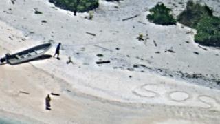 SOS sign on island