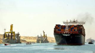 Container ships and pilot boats sail on the waterway of the New Suez Canal in Ismailia, east of Cairo, Egypt, 25 July 2015.