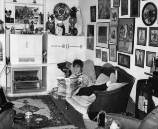 John Lennon at home in his Weybridge house, sometime in the 1960s