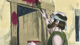 Jewish man painting doorpost with lamb's blood