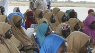 The freed 104 Dapchi girls, one other girl and a boy assembled at the Nigerian Air Force Base in Maidugurion.