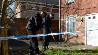 Police search the garden