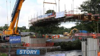 The bridge framework being lowered into position