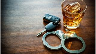 Drink, car keys, handcuffs