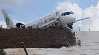 A Toronto-bound Fly Jamaica airplane is seen after crash landing at the Cheddi Jagan International Airport in Georgetown, Guyana on November 9, 2018