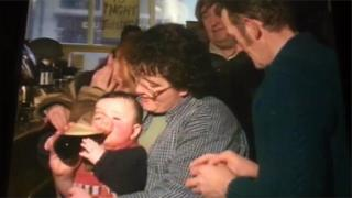 A baby drinking from a pint of Guinness as filmed by RTE