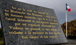 A commemorative plaque is pictured on November 13, 2017 in Villeneuve-d'Ascq, northern France, reminding of the April 2, 1944 WWII massacre of 86 civilians