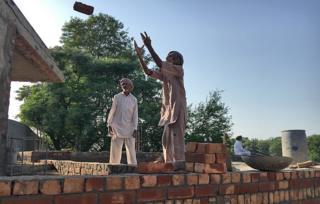 Workers help to build Moom's mosque
