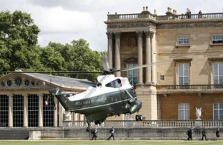 The Marine One helicopter carrying Mr Trump and First Lady Melania Trump arrives in the grounds of Buckingham Palace.