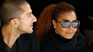 """Artist Janet Jackson (C) and her husband Wissam Al Mana (L) attend the Hermes Spring/Summer 2016 women""""s ready-to-wear collection show in Paris, France, October 5, 2015."""