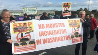 Protesters holding a banner saying 'No monster incinerator' during a November 2017 protest