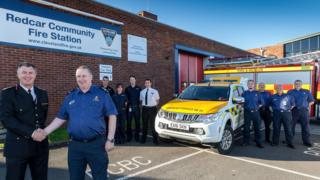 Redcar Coastguard Rescue Team being welcomed to community fire station