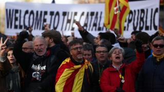 People gather during a protest against Spain's cabinet meeting in Barcelona, Spain, December 21, 2018.