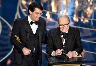 Ennio Morricone onstage with his Italian interpreter