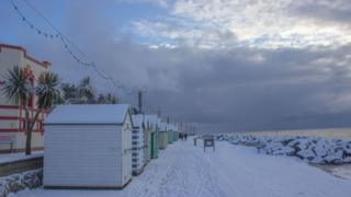 Snowy beach huts in Suffolk