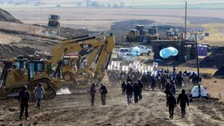 Protesters march along the route of the Dakota Access pipeline near the Standing Rock Indian Reservation in North Dakota. November 11, 201