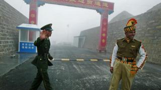 A Chinese soldier and an Indian soldier at their shared border in 2008