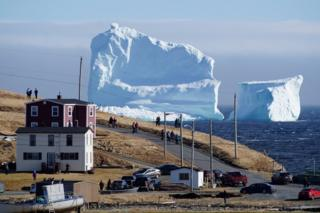 "Residents view the first iceberg of the season as it passes the South Shore, also known as ""Iceberg Alley"", near Ferryland Newfoundland, Canada April 16, 2017."