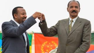Abiy Ahmed and Isaias Afwerki celebrate the reopening of Eritrea's embassy in Addis Ababa