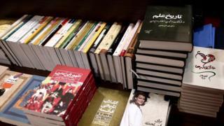 Piles of Persian-language books in an Iranian bookshop