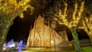 Christmas lights on the trees outside the cathedral