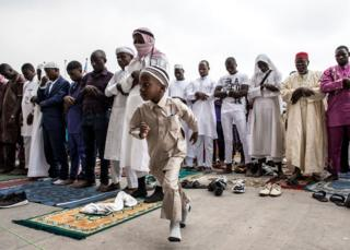 in_pictures A young Muslim worshipper runs off during a mass prayer to celebrate Eid al-Fitr at the Stade des Martyrs in Kinshasa, DR Congo - 4 June 2019