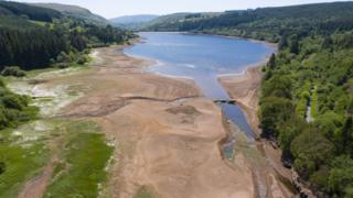 Low water levels in the Llwyn-on reservoir in Taf Fawr valley