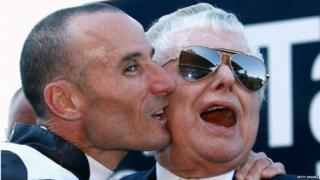 Jockey Glen Boss kisses trainer Bart Cummings after So You Think won the Tatts Cox Plate during the 2009 Cox Plate Day meeting