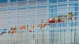All European Union member countries flags reflected in European Parliament facade in Strasbourg, France