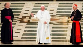 Pope Francis turns to face the congregation as he arrives inside the Basilica of the National Shrine of the Immaculate Conception in Washington, on 23 September 2015 for the Canonization Mass of Blessed Junipero Serra