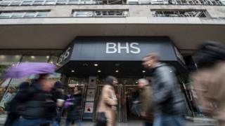 BHS shop front by people walking past