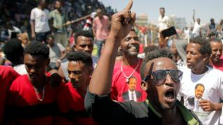 Supporters of Bekele Gerba, secretary general of the Oromo Federalist Congress (OFC), chant slogans to celebrate his release from prison, in Adama, Oromia Region, Ethiopia, 14 February 2018