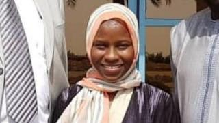 Zainab Aliyu (C) pictured with Nigerian officials in Jeddah shortly after her release from prison
