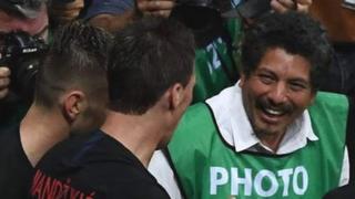 Photographers crowd around the Croatian players
