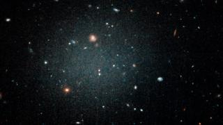 A diffuse fuzzy blob with other galaxies visible behind it