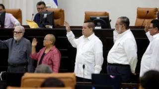 Members of the Truth, Justice and Peace Commission (L to R), Priest Uriel Molina, Mirna Cunigam, Adolfo Jarquin, Cairo Amador and Jaime Francisco Lopez during the swearing-in ceremony at the National Assembly in Managua 6 May 2018