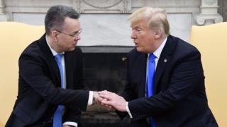 Andrew Brunson, left, in the Oval Office with President Donald Trump