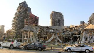 Damaged vehicles and buildings are seen near the site of Tuesday's blast