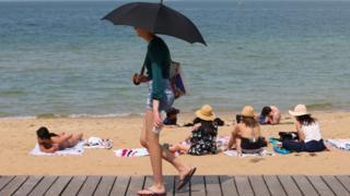 People flock to St Kilda beach as a heat wave sweeps across Victoria, Australia, 18 December, 2019.