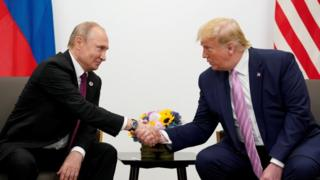 Russia's President Vladimir Putin and US President Donald Trump shake hands during a bilateral meeting at the G20 leaders summit in Osaka, Japan