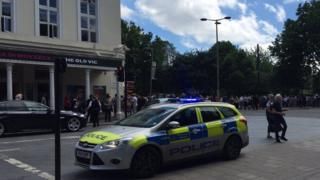 People evacuating the Old Vic Theatre