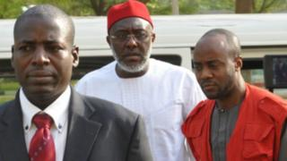 Olisa Metuh with EFCC operatives