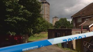 Police tape at flats where a man died