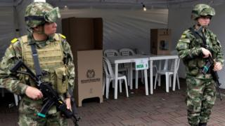 Colombian soldiers stand guard at a polling station in Bogota, 26 May 2018